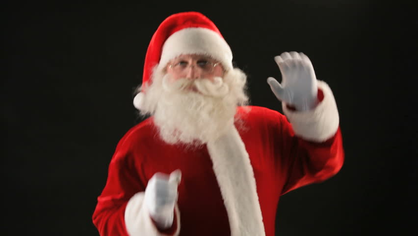 Cheerful Santa Claus dancing against black background