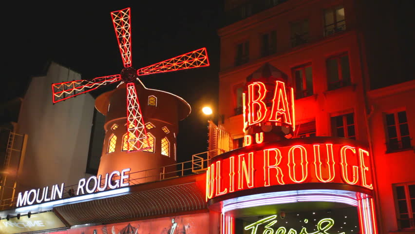 PARIS - OCT.2: The Moulin Rouge by night, on October 2, 2012 in Paris, France. Moulin Rouge is a famous cabaret built in 1889, located in the Paris red-light district of Pigalle