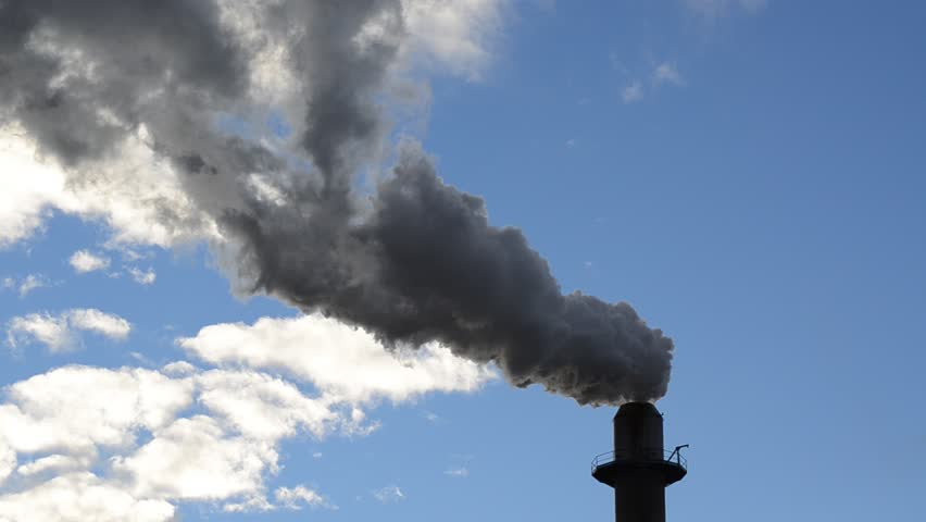 Pollution, smoke and steam discharged from an industrial facility. - HD stock footage clip