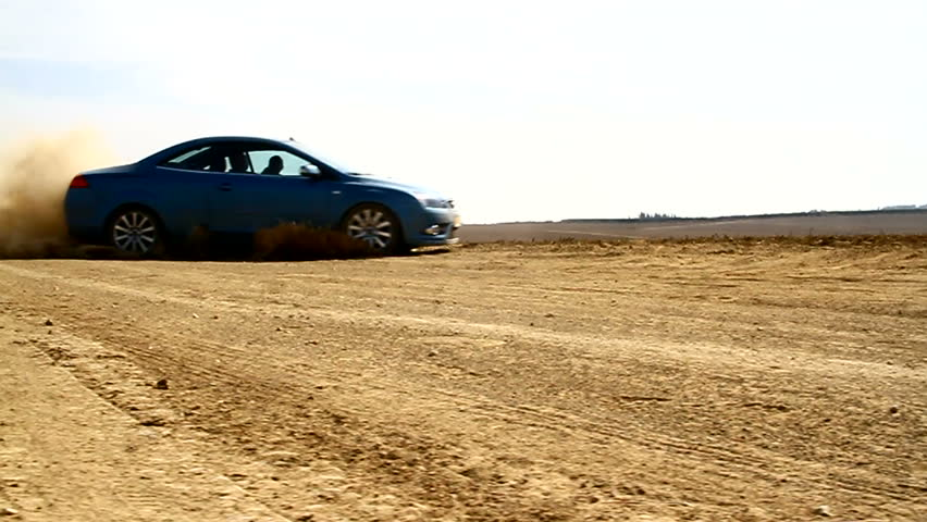 Car Drift's. Dolly Shot.  Car drifting on the high speed and makes a sand cloud.