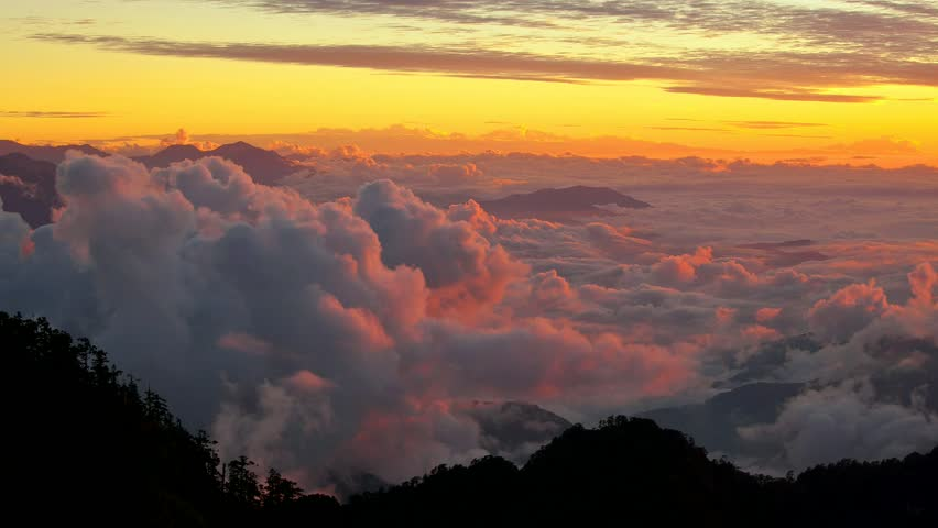 Beautiful timelapsed sunrset through the mountain (High Definition) - HD stock video clip