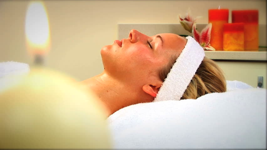 Beautiful blonde girl relaxes at the health spa - HD stock footage clip