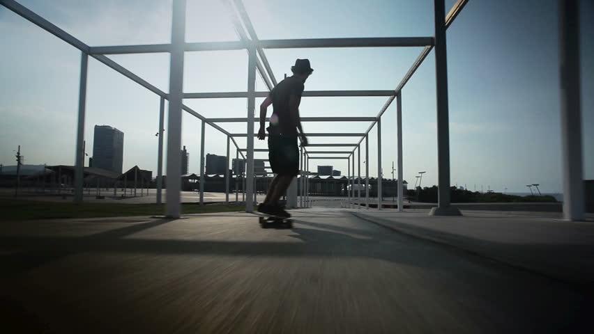 cool guy on his longboard  skate in a great park en Barcelona, Spain.  - HD stock footage clip