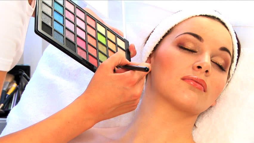 Beautiful brunette girl is pampered at the health spa - HD stock footage clip