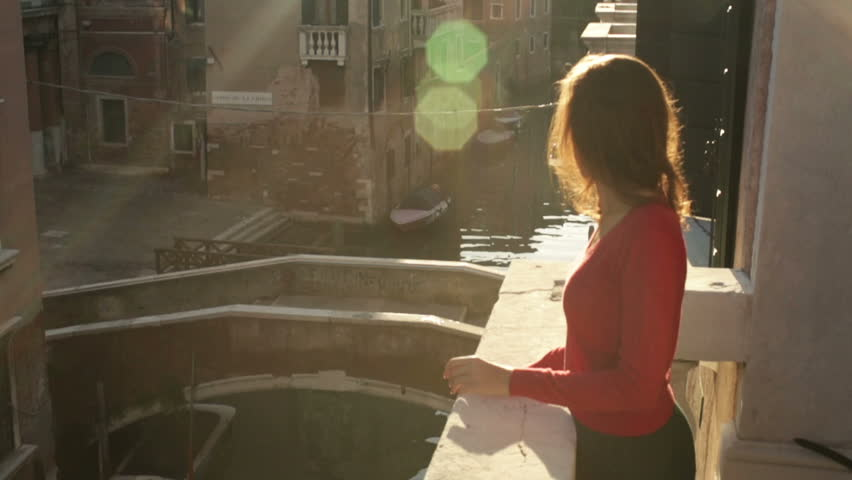 Young girl on a balcony in Venice