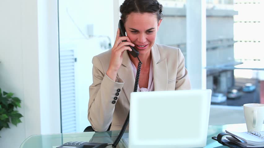 Happy woman in suit working in a bright office - HD stock footage clip