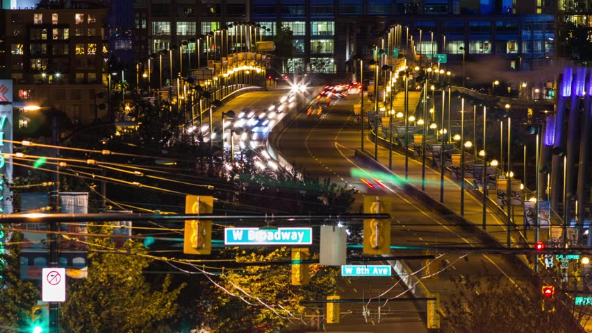 Medium Shot of Time Lapse High Impact Busy Traffic of Cambie Bridge going in and out of Downtown Vancouver. Footage shot with 4k RAW Photo Sequence