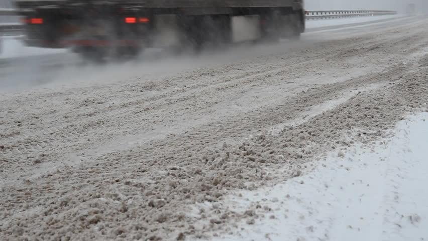 Traffic on snowy road - HD stock footage clip