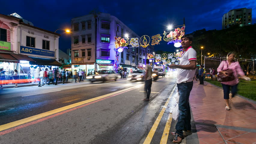 SINGAPORE - 13 NOVEMBER 2012: Night Timelapse of street life in Little India in