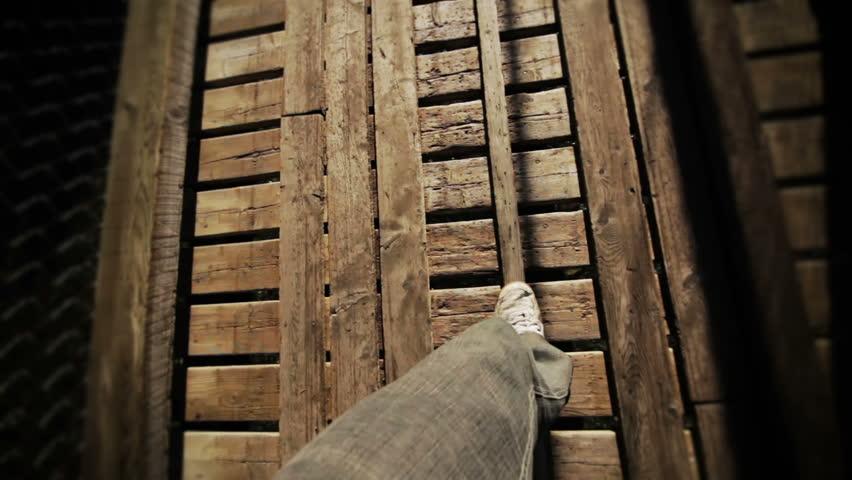 Man Walking on a footbridge  | Shutterstock HD Video #3054511
