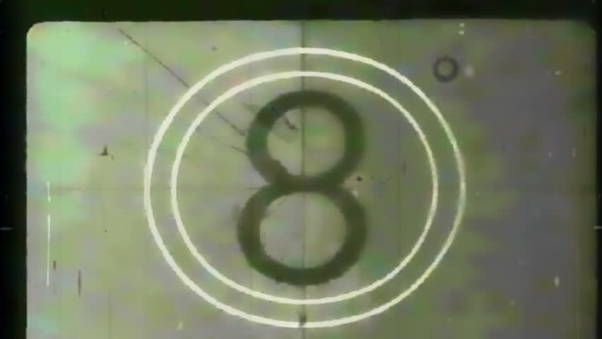 Montage of authentic film leader elements taken from old public domain films, followed by a SMPTE Universal Leader countdown, and ending with several seconds of dust and scratches.