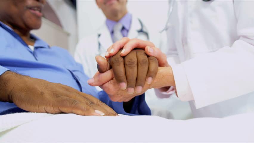 Medical Consultants Reassuring Patient   Shutterstock HD Video #3075292