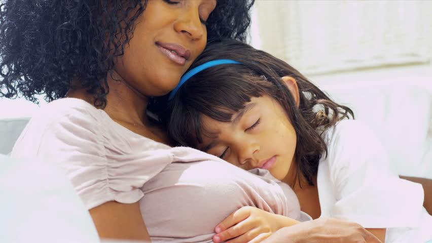 Cute Ethnic Girl Sleeping Mothers Shoulder