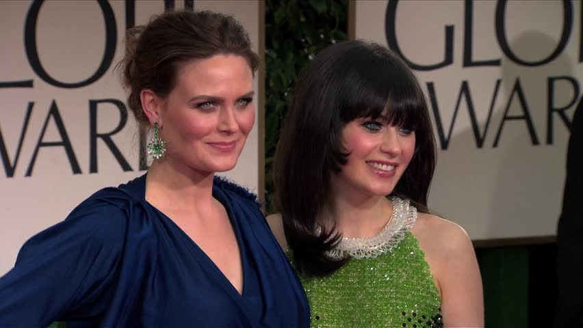 Beverly Hills, CA - JANUARY 15, 2012: Zooey Deschanel, Emily Deschanel, walks the red carpet at the Golden Globe Awards 2012 held at the Beverly Hilton Hotel
