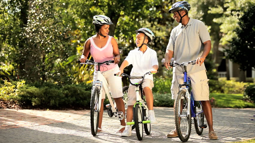 Ethnic family keeping fit together out cycling - HD stock footage clip