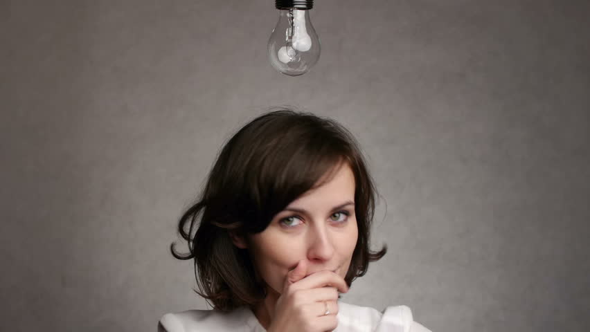 pensive woman gets an idea, which lights up a symbolic lamp over her head