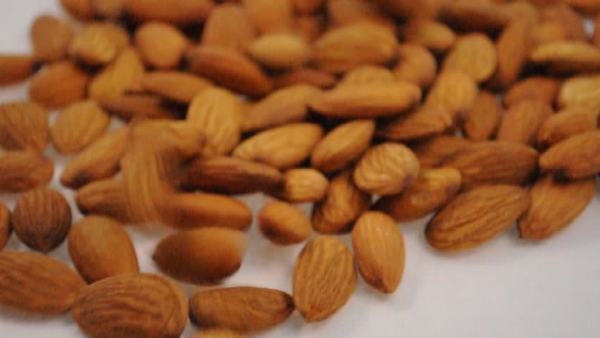 footage of falling almond seeds - HD stock video clip