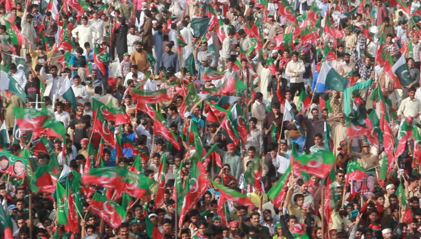SIALKOT, PAKISTAN - MAR 23: Massive crowd support for cricket turned politician Imran Khan during a political rally at Jinnah Cricket Stadium on March 23, 2012 in Sialkot, Pakistan - HD stock video clip