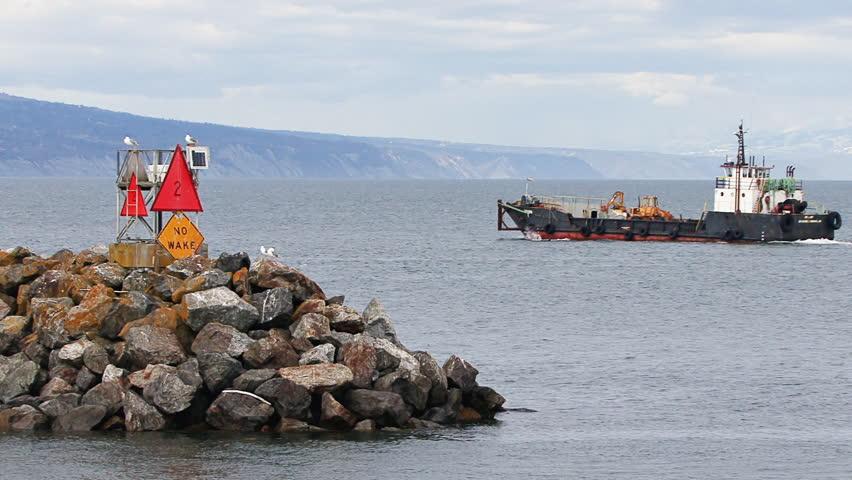 HOMER, AK - CIRCA 2012: Large industrial landing craft leaving Homer Harbor,