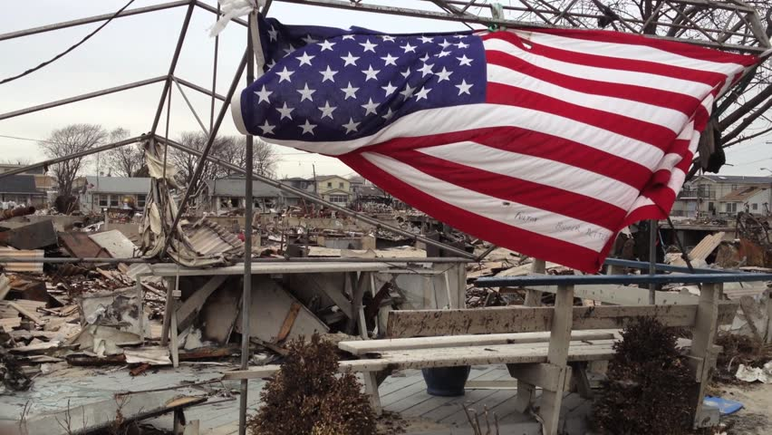 BREEZY POINT, QUEENS, NY-December 2, 2012: Video clip of wreckage and debris from homes destroyed by devastating fire during Hurricane Sandy.  Clip pans across wreckage, ends up on American flag.