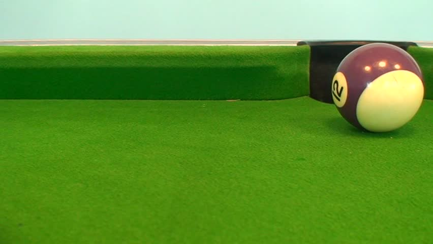 Tracking shot of a 12 ball pot on pool table - SD stock video clip