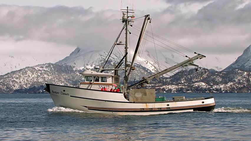 HOMER, AK - CIRCA 2012: An Alaskan trawler returns to port just off the Homer
