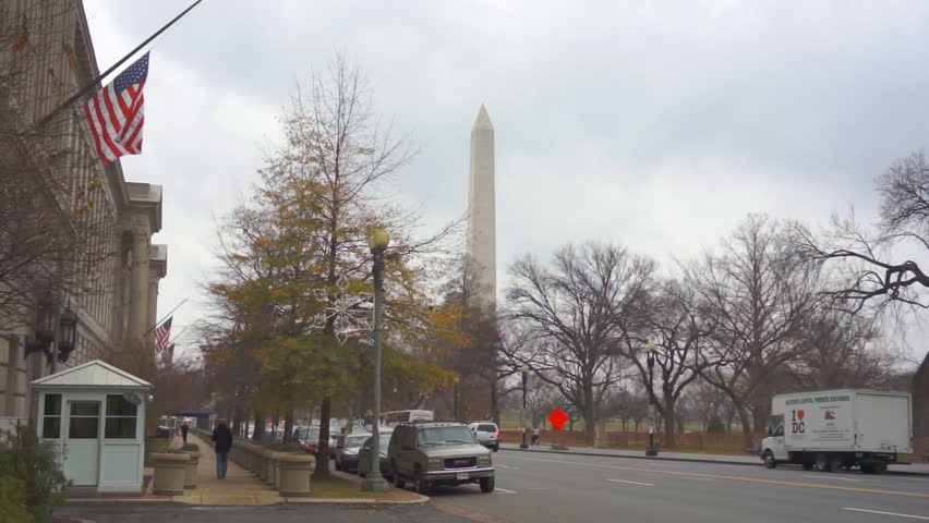 WASHINGTON DC - DECEMBER 15: American flags are hung at half mast on Federal Government Buildings in mourning of the Newtown, CT elementary school shooting on December 15, 2012 in Washington DC. - HD stock video clip