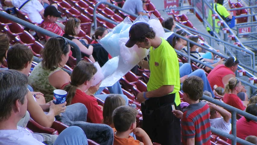 CINCINNATI - SEPTEMBER 2: Food vendor (name withheld) from Cincinnati, OH selling cotton candy during a Cincinnati Reds baseball game September 2, 2008 in Cincinnati, Ohio. - HD stock footage clip