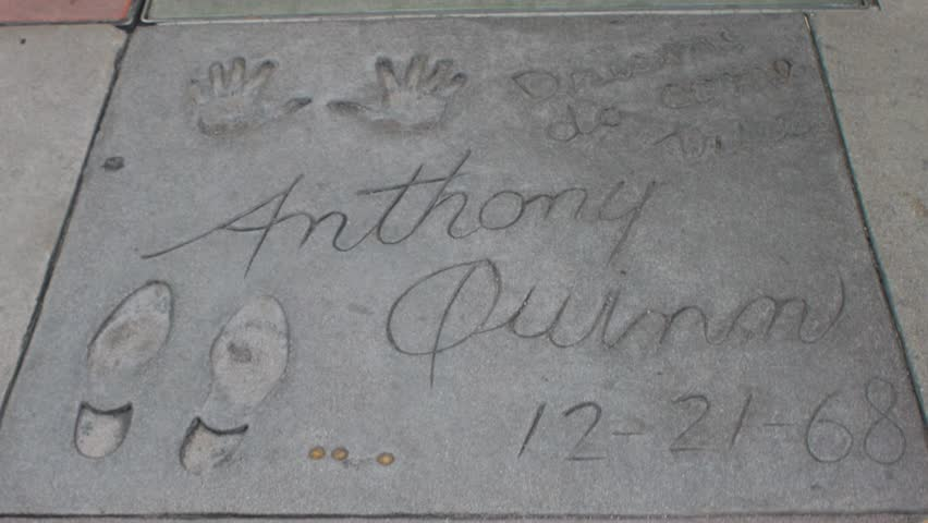 HOLLYWOOD, CA - CIRCA 2011: Boot prints and hand prints of Anthony Quinn at Graumann's Chinese Theater in Hollywood, California. - HD stock video clip