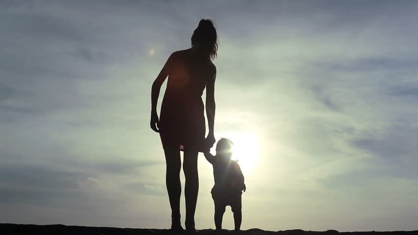 Young mother keeping her baby child by the hand and going forward | Shutterstock HD Video #3168190