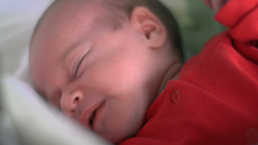 Beautiful infant baby girl in bed  - HD stock footage clip