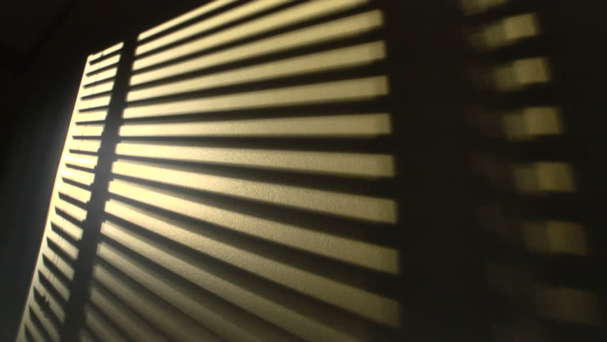 Time Lapse Shot Of The Sun Shining Through Window Blinds