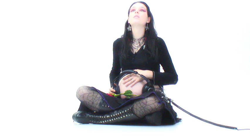 """Pregnant """"Goth"""" girl sits - listening to headphones - HD stock footage clip"""