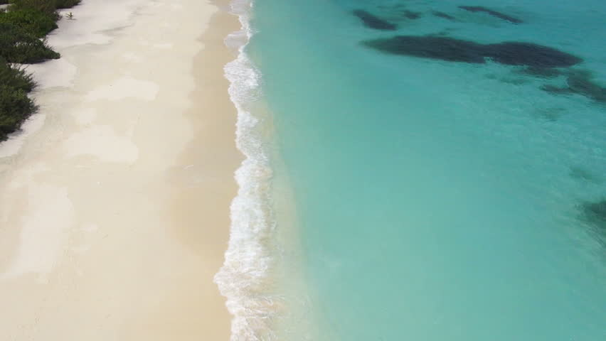 aerial view tropical lagoon, waves and sandy beach