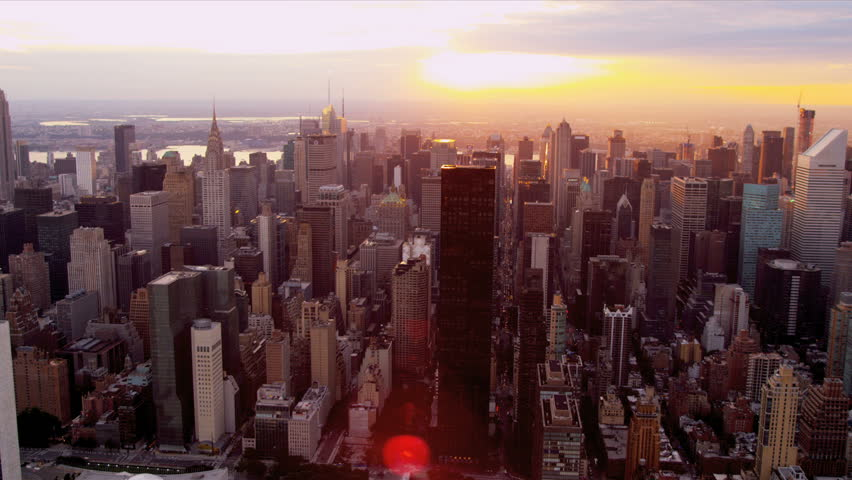 Aerial view midtown Manhattan skyscrapers and Empire State Building at sunset, New York, North America | Shutterstock HD Video #3244015