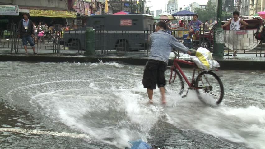 MANILA, PHILIPPINES - AUGUST 2012: Flood Waters Surge Through Streets Of Manila Philippines. Shot on Sony EX1 XDCAM in full HD 1920x1080 30p .