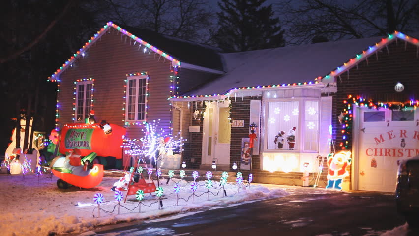 North American Houses Brightly Light With Christmas Lights And Decorations At Night
