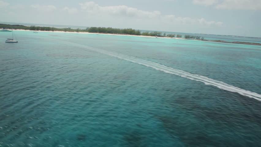Aerial of speedboat cutting through the ocean