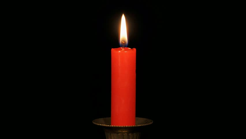 Continuous Loop Of A Burning Red Candle On A Black ...