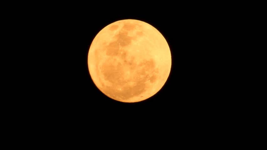 Full Super moon passes fast time lapse across black night sky