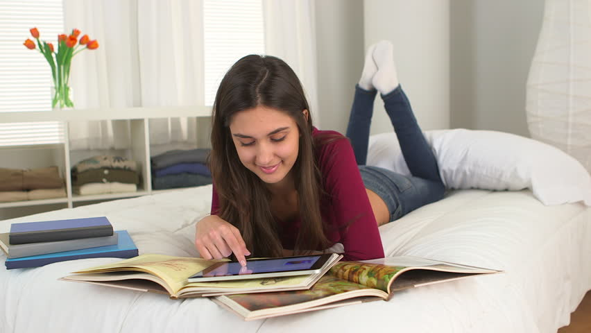 Young Caucasian student studying on her bed - HD stock footage clip