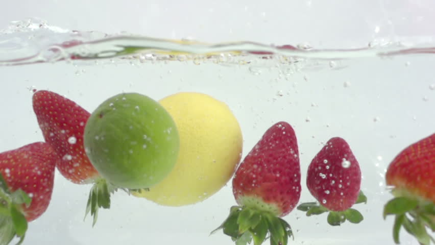 fresh fruit dropped into water shot in super slow motion with the sony FS700 high speed camera