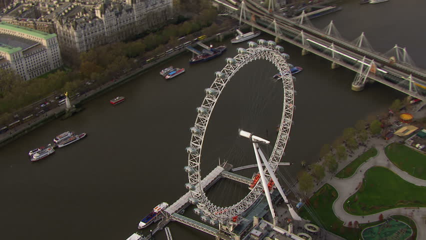 LONDON - NOVEMBER 2012: Aerial view of the London eye observation wheel and the surrounding area. The eye sits beside the river Thames and opposite the city of Westminster. London, UK 22 November 2012