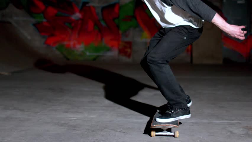 Front view of skater doing double kickflip trick in slow motion - HD stock footage clip