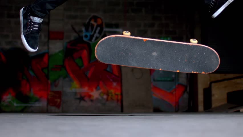 Close up of skater doing 360 flip trick in slow motion - HD stock video clip