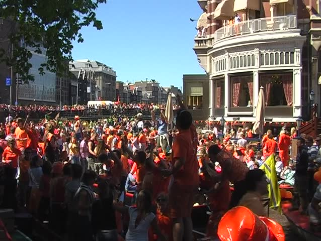 Large dutch crowd on boats during queensday in Amsterdam Netherlands - SD stock footage clip
