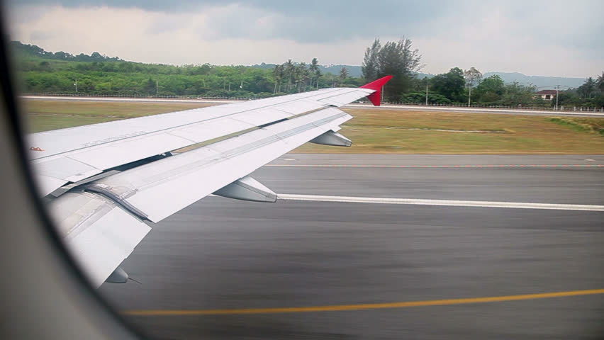 Takeoff. The view from the airplane window. Phuket airport. Thailand