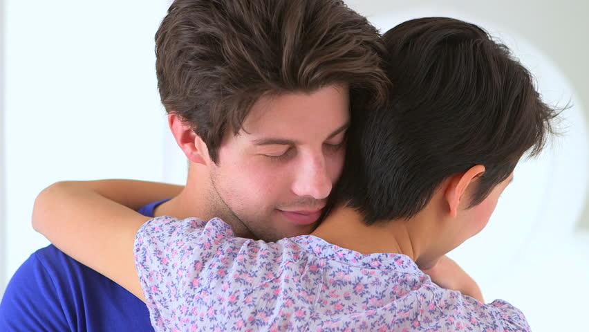 Boyfriend hugging his girlfriend