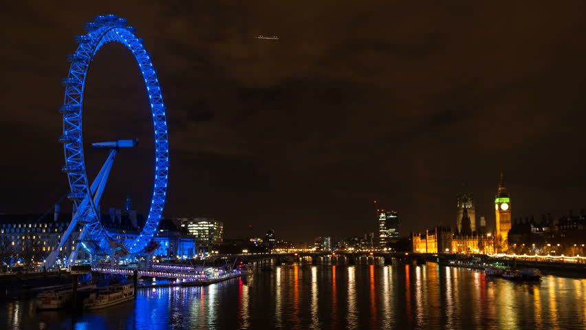 LONDON - APRIL 14: London skyline night view with London Eye on April 14, 2013 in London, UK. London Eye is the tallest Ferris wheel in Europe at 135 meters.  - HD stock footage clip