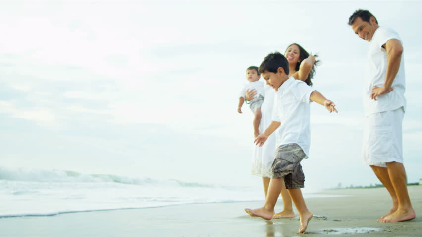 Young Hispanic loving family spending vacation on beach shot on RED EPIC - HD stock video clip
